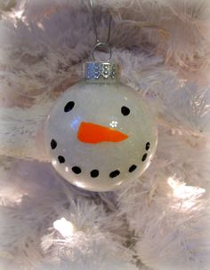 Turn a clear glass ornament into a Christmas snowman