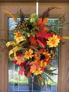 Adorn your door this fall with a beautiful fall floral grapevine wreath.  Is fall your favorite time of year?  It is mine.  I love the colors of fall and this fall grapevine wreath is full of the changing colors.  This wreath is perfect for your front door and will make neighbors take a double take.  How gorgeous will your porch be with the perfect grapevine wreath?! A personal favorite from my Etsy shop https://www.etsy.com/listing/522085146/fall-grapevine-wreath-fall-floral
