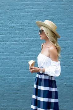 Loving this off the shoulder top in white paired with a beautiful skirt. Perfect summer style