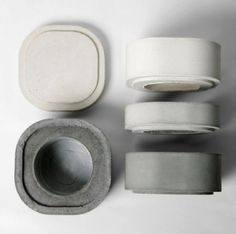 Concrete Modular Vases: Designer Xiral Segard was inspired by Japanese bento boxes and created these concrete Konkurïto vases, items with modular design and clearness. These vases are made of four modular stackable elements so depending on the size of the bouquet the water reservoir can be located at the top or bottom.
