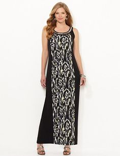 Our soft, stretch maxi is sure to be the talk of the town with all of its fashion-forward details. The center panel design wraps to the back with pops of neon color throughout. A stand of metallic beads lines the scoop neckline for an accessorized finish. Double back button closure. Catherines plus size dresses are expertly designed to flatter your figure. catherines.com