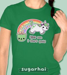 """Super cute t-shirts featuring a green shamrock unicorn farting out gold into the pot at the end of the rainbow. Includes the quote """"Kiss Me, I Fart Gold."""" The perfect t-shirt for St. Patrick's Day."""