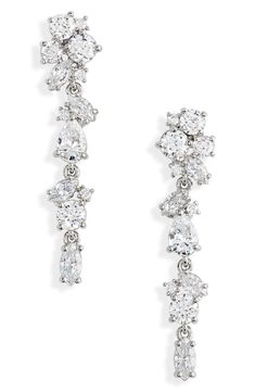 Faceted stones and crystals sparkle on these endlessly elegant linear drop earrings. Style Name:Nordstrom Cubic Zirconia Linear Drop Earrings. Style Number: Available in stores. Bridal Wedding Dresses, Wedding Dress Styles, Berta Bridal, Bridal Accessories, Wedding Jewelry, Designer Wedding Shoes, Grace Loves Lace, Wedding Earrings, Bridal Boutique