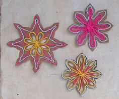 Recycled Cardboard and Yarn Snowflakes- great way to add color to a dreary winter day!