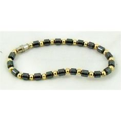 Bracelet of gold/charcoal grey beads. | Oxfam GB | Oxfam's Online Shop