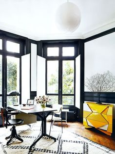 I'm moving in Love the rug and the desk and that black paint on the trim. 20 Beautiful Rooms with Beni Ourain Rugs
