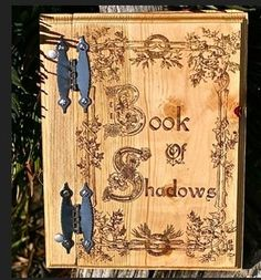 "Each Book of Shadows is Handcrafted by Fey. - 12"" x 13"" - Solid Pine Wood - Natural stain color and sealed - Highly detailed border of leaves and Celtic knots interlocking inside the letters - 50 page"