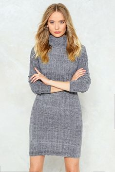 You're getting warmer. The Keep Me Warm Dress comes in a knit and features a fitted silhouette, ribbed turtleneck, long sleeves, and slight stretch fit.