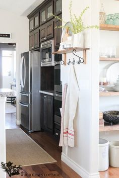 Side storage for dish towels also?   Home Tour - The Wood Grain Cottage