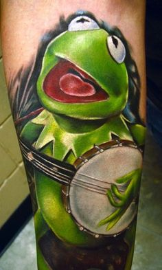 It's not easy playing a banjo, especially when you're green. #InkedMagazine #banjo #kermit #tattoo #tattoos #Inked #ink #Puppet
