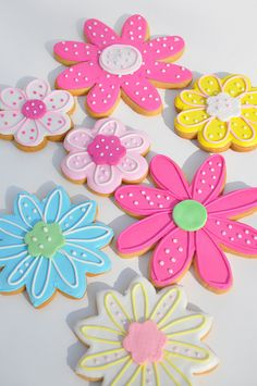 FLOWER COOKIES- I like the speckled one in the back