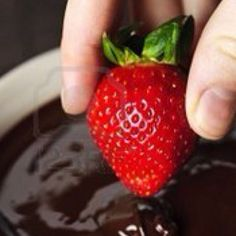 Strawberry dipped in melted dark chocolate