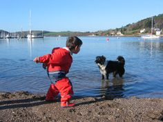 Dougie and a Dog - taken in Crosshaven, Co. Cork in 2005. Dougie is wearing the Everyday Dungarees and Jacket:   http://www.puddleducks.ie/boys/waterproofs.html