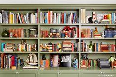 Green bookshelves filled with books