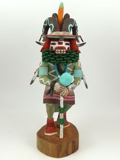 "Ram (Pong) Kachina Holding a Rattle, Hand Carved from Cottonwood Root and Hand Painted. 7.25"" Doll Height, 10.25"" Overall Height"