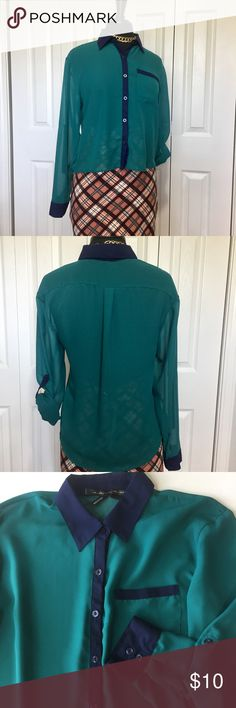 Ali and Kris long sleeve sheer blouse This blouse is perfect for the office. Teal with navy accents. It is sheer and has tabs for securing rolled up sleeves. Has a strange area near left collar that seems to be part of the weave. This top has been washed so it is not something on it. There are a few micro flaws, but they are difficult to find. Measurements taken flat and in inches. Shoulder to shoulder 171/4. Armpit to armpit 193/4. Sleeve 221/2. Front length 181/2. Back length 241/2. Ali…