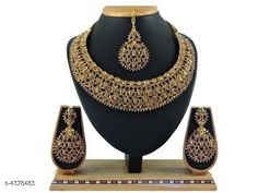 Jewellery Set Trendy Stylish Alloy Women's Jewellery Set  Base Metal: Alloy Plating: Gold Plated Stone Type: American Diamond Sizing: Adjustable Type: Necklace Earrings Maangtika Multipack: 1 Country of Origin: India Sizes Available: Free Size   Catalog Rating: ★4.3 (446)  Catalog Name: Shimmering Chunky Jewellery Sets CatalogID_629151 C77-SC1093 Code: 504-4378483-2301