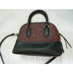 Black and Brown Faux Leather Purse MAKE AN OFFER THROUGH OFFER OPTION POSHMARK TRANSACTIONS ONLY GET 25% OFF BUNDLING THREE ITEMS NO TRADES - NO HOLDS  Never used. Found something bigger. Adjustable strap  and has handles. To side pockets and one zipper pocket on inside. Bags Crossbody Bags