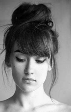 The perfect messy topknot with bangs. http://www.stuffdot.com/index.php?tid=beaf8f9ca0e0ef24dbb15e9aef5dc2fa