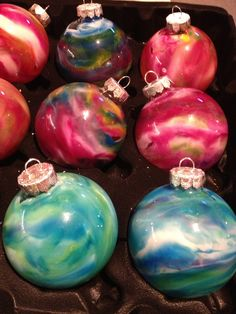 Melted Crayon Ornaments! Take the top off, drop in bits of crayon (colors mix to make other colors), top back on and hold, Use hair dryer heat to the crayons until they begin to melt, & swirl.