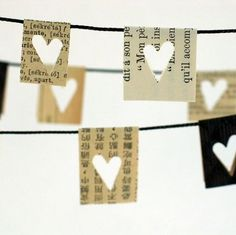 little paper hearts //yarn or some other type thin cord. Cut pieces from book/newspaper and fold over yarn/cord. Punch hearts into paper. This would be great as a garland for Valentine's day. Use other style punches for other holidays. Paper Heart Garland, Flag Garland, Paper Bunting, Diy Garland, Garland Ideas, Mini Bunting, Paper Garlands, Bunting Banner, Mantle Garland