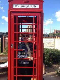 Viking's Fan in red phone booth on Stone Arch Bridge | #VikingsInUK