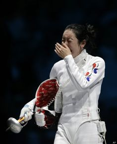 Oh Come On! No Fair!  South Korea's Shin A-lam reacts after a women's individual epee fencing semifinals match against Germany's Britta Heidemann at the 2012 Summer Olympics, Monday, July 30, 2012, in London. (AP Photo/Andrew Medichini)