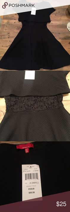 Black dress with lace mesh detail Black short sleeve dress. The dress has a texture to it and below the top has a lace mesh detail as soon in photo. Dress is form fitting. Size XS Saks Fifth Avenue Dresses
