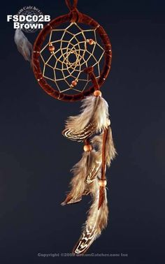 This 2.5 inch Contemporary Dreamcatcher is available in tan and brown and has beautiful wooden and metal beads in the webbing.