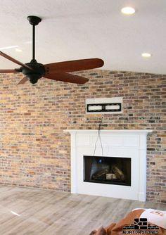 A cozy living room with a brick fireplace.  #mortonstones #brick #tiles #rustic #home #decor #brickveneers  #interior #accent #wall #rustic #livingroom #interiordesign #fireplace #cozyhome