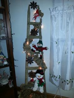 Tobacco stick ladder with handmade snowmen. By Ginger Claypool