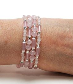 I love this memory wire bracelet that features four rows of 4mm and 6mm (1/4) natural rose quartz together with perfectly-matching matte recycled (sea) glass tube beads and small bright silver heishi. The bracelet should fit most women. To see other gemstone memory wire bracelets, please