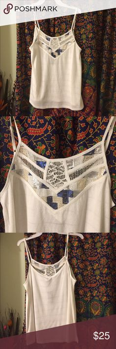 Miss Me Tee Shimmer and Shine in this Miss Me Tee. Size Medium. White with Blue, Silver and Gold embellishments. The white material has small detail in it which makes it very attractive! NWT Miss Me Tops Camisoles