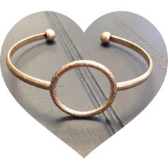 Cute cuff NWOT cute little cuff! The color is a blend of copper and gold. Jewelry Bracelets