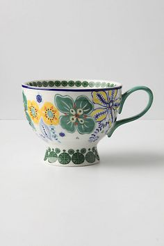 The touch of a mug, the feel of a mug and the artistry of a mug are what make my beverages perfect! :) I own these mugs in every variety and use them EVERYDAY!!! One of my FAVORITE things! (sung w/Julie Andrews voice!hehe :) ) You can find them at Anthropologie...My all time FAVORITE store. ;)