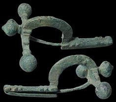 "Roman, 3rd - 4th Century AD. Nice large bronze ""Crossbow-fibula."" Roman soldier's / Legionary type, with high arched body for thick material to fit through. Worn over the shoulder. With original pin and terminals, top one reattached. Nice green patina."