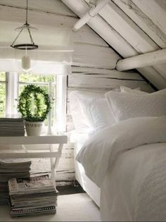There is nothing better than a crisp white bedroom :) .well maybe a crisp white bedroom in a loft. Style Cottage, White Cottage, White Cabin, Cozy Cottage, Swedish Cottage, Rustic Cottage, Attic Rooms, Attic Bed, Attic Bathroom