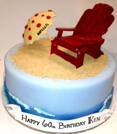 Beach themed cake with Adirondack chair and umbrella
