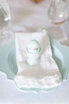 Spring table setting with ruffled linen napkins and egg place cards photographed by Alea Lovely