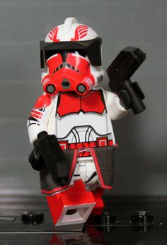 P2 Commander Thorn. Features dual rex pistols, black visor and black waistcape with red trim