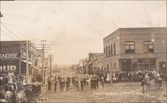 RP: Band playing on Main Street [dirt] , WIBAUX , Montana , PU-1912