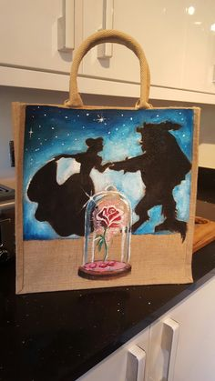 Beauty and the beast hand painted jute bag by Drews Jutes