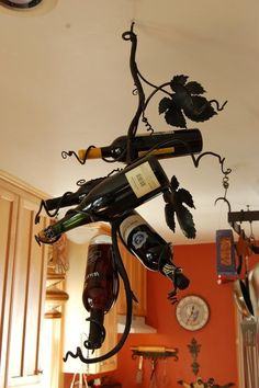 How awesome is this! A hanging wine rack with grape leaves and vines!! This is also going to the wish list.