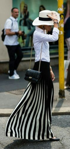White shirt, pleated maxi skirt and Chanel bag for spring street style. #chanel #maxiskirt #whiteshirt