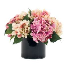 Faux hydrangea arrangement in glass vase. Made in the USA.   Product: Faux floral arrangementConstruction Material: Fabric, polyester and glassColor: Pink and blackFeatures: Includes faux hydrangeasDimensions: 12 H x 14 Diameter Note: This product is supplied by Natural Decorations, Inc. Cleaning and Care: NDI Newlife recommended for cleaning