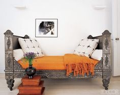 French iron daybed, from the early 19th century, resides in the home office / guest room of designer Susan Chalom....thick orange mohair blankets! via Northern Light blog.