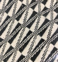 A close up of the handwoven cotton cushion cover I got for my DiL for Xmas... she has a penchant for B&W geometrical... message me if you would like one... it is made by Thai weavers I am working with.