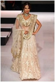 Malaika Arora in a gorgeous cream and gold Indian bridal lengha  #indianfashion <3
