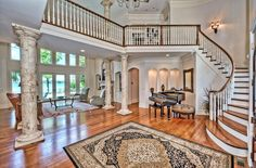 Open large foyer, with grand staircase.