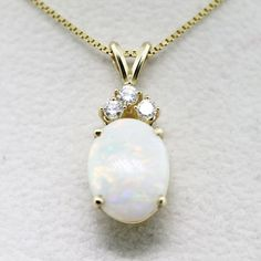 Spotlight on Opal Jewelry - If my dress allowed me to have a necklace, I think this one would match my ring beautifully :] - Opal Jewelry, Gemstone Necklace, Luxury Jewelry, Fine Jewelry, Silver Jewelry, Pendant Jewelry, Diamond Jewelry, Jewelry Making, Pendant Necklace